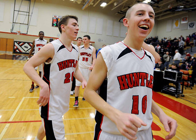 Sarah Nader - snader@shawmedia.com Huntley's T.J. Adams (right) celebrates after winning Saturday's game against Dundee-Crown on February 11, 2012. Huntley won, 41-40.