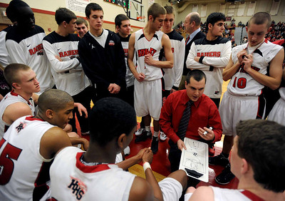 Sarah Nader - snader@shawmedia.com Huntley's head couch Marty Manningr talks with the team during  Saturday's game against Dundee-Crown on February 11, 2012. Huntley won, 41-40.
