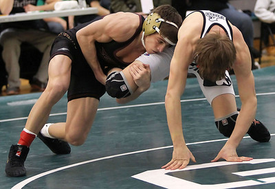 Candace H. Johnson – Shaw Suburban Media Richmond-Burton's Cameron Kennedy (left) uses a single leg takedown against Fenwick's Matt Garelli in the 120 lb. weight class finals during the IHSA Grayslake Central AA Sectional. Fenwick's Matt Garelli won by a decision 8-6 in overtime.