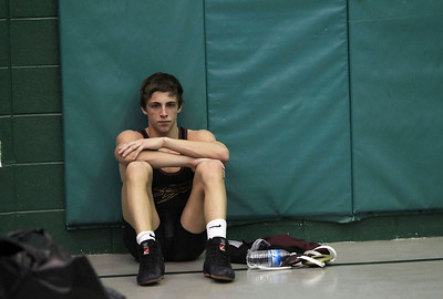 Candace H. Johnson – Shaw Suburban Media Richmond-Burton's Cameron Kennedy sits alone after losing to Fenwick's Matt Garelli in the 120 lb. weight class finals during the IHSA Grayslake Central AA Sectional. Fenwick's Matt Garelli won by a decision 8-6 in overtime.