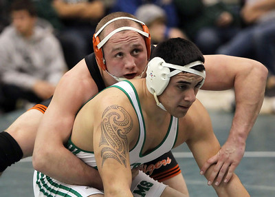 Candace H. Johnson – Shaw Suburban Media Crystal Lake Central's Gage Harrah stays on top in the referee's position against Grayslake Central's Joey Valdivia in the 195 lb. weight class finals during the IHSA Grayslake Central AA Sectional. Harrah won by a major decision 14-6.