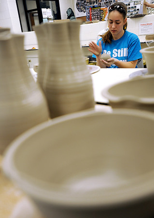 Sarah Nader - snader@shawmedia.com McHenry County College student  Molly Tait of McHenry creats a bowl at McHenry County College on Sunday as part of the project Empty Bowls 2010, a national grass roots movement to help end hunger. The bowls will eventually be filled with soup and sold to the public at Oakton Community College in December.