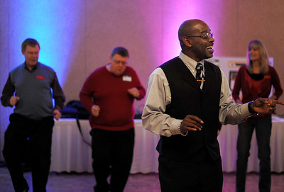 Sarah Nader - snader@shawmedia.com Dance instructors Cinnamon Trammell (center) shows the crowd merengue dance steps during Sunday's First Dance event hosted by Gulbrandson Orthotics & Prosthetics at the Holiday Inn in Crystal Lake on February 12, 2012. People with physical challenges were taught how to dance by instructors at the Center for Ballroom and Dance in Deer Park.