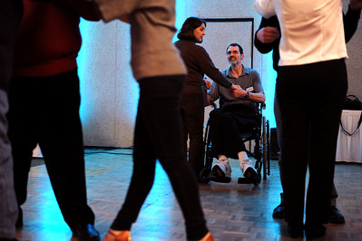 Sarah Nader - snader@shawmedia.com Carter Lamb (center) and his wife Barb Lamb of Cary dance a waltz during a First Dance event hosted by Gulbrandson Orthotics & Prosthetics at the Holiday Inn in Crystal Lake on February 12, 2012. People with physical challenges were taught how to dance by instructors at the Center for Ballroom and Dance in Deer Park.