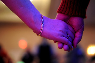 Sarah Nader - snader@shawmedia.com Two people hold hands during the First Dance event hosted by Gulbrandson Orthotics & Prosthetics at the Holiday Inn in Crystal Lake on February 12, 2012. People with physical challenges were taught how to dance by instructors at the Center for Ballroom and Dance in Deer Park.