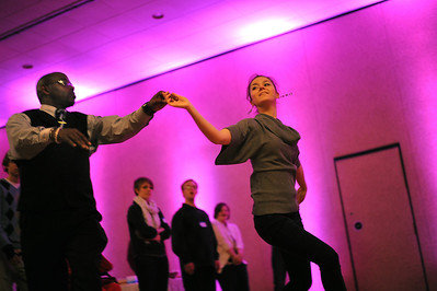 Sarah Nader - snader@shawmedia.com Dance instructors Alisa Alyabyeva (right) and Cinnamon Trammell show the crowd how to waltz during Sunday's First Dance event hosted by Gulbrandson Orthotics & Prosthetics at the Holiday Inn in Crystal Lake on February 12, 2012. People with physical challenges were taught how to dance by instructors at the Center for Ballroom and Dance in Deer Park.