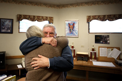 Daniel J. Murphy - dmurphy@shawmedia.com  Bob Jujewski gives administrative secretary Vicky Seyller a hug goodbye Monday February 13, 2012 in McHenry. Jujewski retired from the McHenry Township Fire Protection District after 35 years of service.