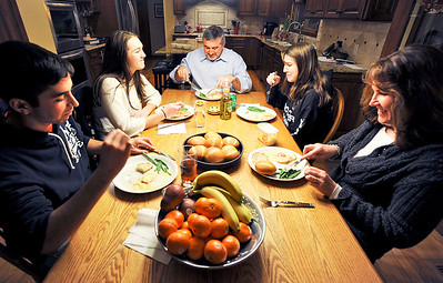 Sarah Nader - snader@shawmedia.com The Thorpe family, Beth (right), Casey,14, Jim, Melissa, 17, and foreign exchange student Augustin Santellan, 17, of Argentina sit down for dinner at the Thorpes home in Crystal Lake on Monday, February 13, 2012. Last year Melissa spent 10 months in Argentina as a foreign exchange student and now her family is hosting Santellan for the school year.