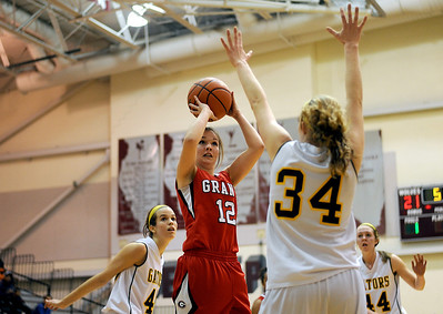 Sarah Nader - snader@shawmedia.com Grant's Kassie Stimpson (center) takes a shot during the third quarter of Monday's Prairie Ridge Regional play-on game against Crystal Lake South on February 13, 2012. Crystal Lake South won, 43-42.