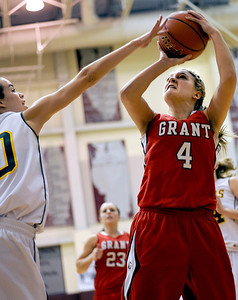 Sarah Nader - snader@shawmedia.com Crystal Lake South's Kayla Peterson (left) jumps to block a shot by Grant's Morgan Johnke during the fourth quarter of Monday's Prairie Ridge Regional play-on game in Crystal Lake on February 13, 2012. Crystal Lake South won, 43-42.