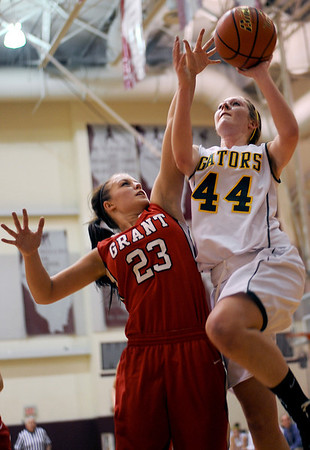 Sarah Nader - snader@shawmedia.com Grant's Caitlin Wedge (left) jumps to block a shot by Crystal Lake South's Lauren Del Vecchio during the second quarter of Monday's Prairie Ridge Regional play-on game in Crystal Lake on February 13, 2012. Crystal Lake South won, 43-42.