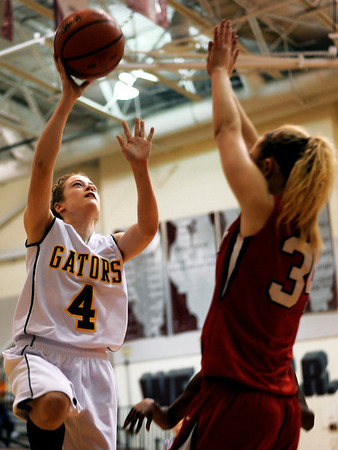 Sarah Nader - snader@shawmedia.com Crystal Lake South's Carina Madoni (left) is guarded by Grant's McKenzie Burton during the second quarter of Monday's Prairie Ridge Regional play-on game in Crystal Lake on February 13, 2012. Crystal Lake South won, 43-42.