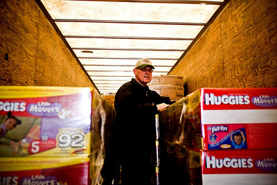 Lance Booth - lbooth@shawmedia.com Larry Eils, of Harvard, helps to move diapers into the new warehouse of the St. Paul Diaper Bank in McHenry on Wednesday, February 15, 2012. The diapers where previously stored at St. Paul Episcopal Church, but the bank was looking for more room to store diapers.