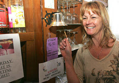 H. Rick Bamman - hbamman@shawmedia.com Amy Barry, new owner of the Corner Tap	in McHenry rings the tip bell behind the bar on Main Street. The Corner Tap has undergone a renovation and is coming back as a neighborhood corner tavern, with large-screen TVs, drink specials, Chocolate Martinis and karaoke on Wednesday nights.