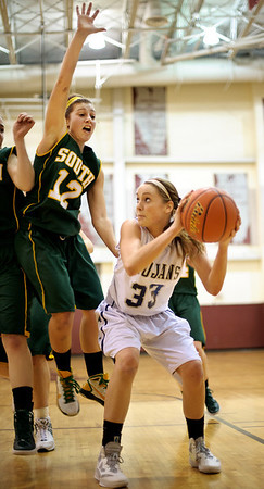 Daniel J. Murphy - dmurphy@shawmedia.com  Cary-Grove's Paige Lincicum (right) fakes out Crystal Lake South defender Stephanie Melone (left) on a lay-up attempt in the third quarter Wednesday February 15, 2012 at Prairie Ridge High School in Crystal Lake. Cary-Grove defeated Crystal Lake South 28-27.