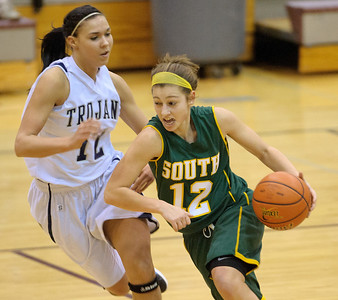 Daniel J. Murphy - dmurphy@shawmedia.com  Crystal Lake South guard Stephanie Melone (right) zips past Cary-Grove's Joslyn Nicholson (left) in the first quarter Wednesday February 15, 2012 at Prairie Ridge High School in Crystal Lake. Cary-Grove defeated Crystal Lake South 28-27.