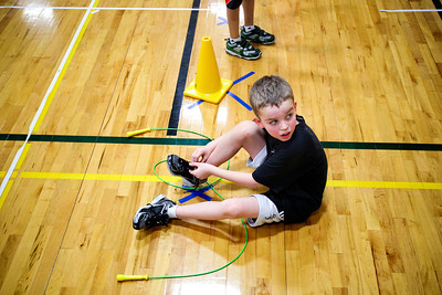 Jenny Kane - jkane@shawmedia.com Kyle Zimmer, 8, takes a second to tie his shoes during Martin Elementary's Jump Rope for Heart. It is the schools ninth year participating in Jump for Heart. The program is designed to teach participants about the benefits of regular exercise and a healthy lifestyle, as well as emphasize the importance of physical fitness to reduce the risk of cardiovascular disease. On Thurs. Feb. 16, Martin Elementary's will hold its third annual Hoops for Heart event. The events promote teamwork, they build school spirit, and give students the opportunity to contribute to their community.