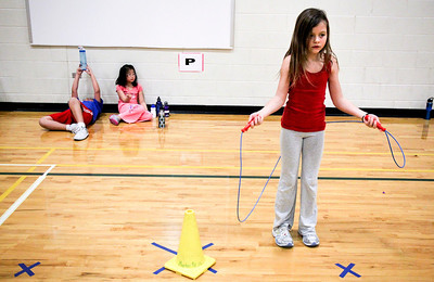 Jenny Kane - jkane@shawmedia.com Maria Mercurio jumps rope while Elizabeth Chong and Alex Rojas take a break during Martin Elementary's Jump Rope for Heart. It is the schools ninth year participating in Jump for Heart. The program is designed to teach participants about the benefits of regular exercise and a healthy lifestyle, as well as emphasize the importance of physical fitness to reduce the risk of cardiovascular disease. On Thurs. Feb. 16, Martin Elementary's will hold its third annual Hoops for Heart event. The events promote teamwork, they build school spirit, and give students the opportunity to contribute to their community.
