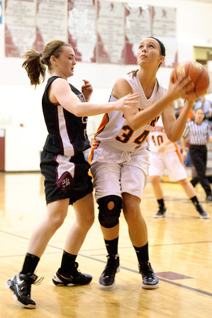Daniel J. Murphy - dmurphy@shawmedia.com  McHenry center Meghan Mortell (right) puts up a basket in the second quarter Wednesday February 15, 2012 at Prairie Ridge High School in Crystal Lake. Prairie Ridge defeated McHenry 38-34.