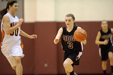 Daniel J. Murphy - dmurphy@shawmedia.com  Prairie Ridge guard Brianne Fenton (right) sprints past McHenry center Brittany Avonts (left) in the first quarter Wednesday February 15, 2012 at Prairie Ridge High School in Crystal Lake. Prairie Ridge defeated McHenry 38-34.