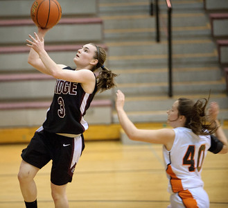 Daniel J. Murphy - dmurphy@shawmedia.com  Prairie Ridge guard Brianne Fenton (left) breaks away from McHenry forward Michelle Kelly (right) in the first quarter Wednesday February 15, 2012 at Prairie Ridge High School in Crystal Lake. Prairie Ridge defeated McHenry 38-34.