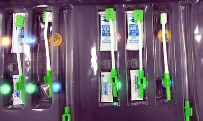 H. Rick Bamman - hbamman@shawmedia.com QCare kits of oral swabs assembled at Sage Products in Cary.