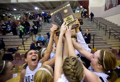 Jenny Kane - jkane@shawmedia.com Cary Grove's Joslyn Nicholson, (left) and Olivia Jakubicek, (right) celebrate with their team after winning the regional IHSA Class 4A regional tournament at Prairie Ridge high school.