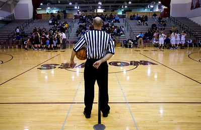 Jenny Kane - jkane@shawmedia.com A referee watches as Cary Grove and Prairie Ridge take a break in-between the first and second period of the regional IHSA Class 4A championship game at Prairie Ridge high school. Cary Grove defeated Prairie Ridge 34-25.