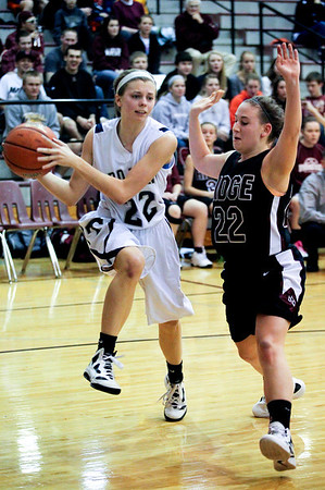 Jenny Kane - jkane@shawmedia.com Cary Grove's Megan Leisten attempts to pass while being gaurded by Prairie Ridge's Haleigh Danek during the regional IHSA Class 4A championship game at Prairie Ridge high school. Cary Grove defeated Prairie Ridge 34-25.