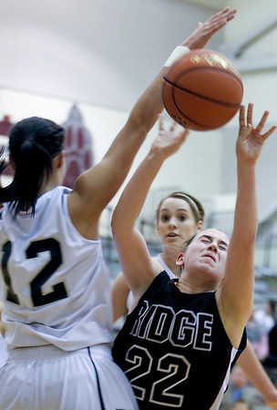 Jenny Kane - jkane@shawmedia.com Cary Grove's Joslyn Nicholson blocks Prairie Ridge's Haleigh Danek shot during the regional IHSA Class 4A championship game at Prairie Ridge high school. Cary Grove defeated Prairie Ridge 34-25.