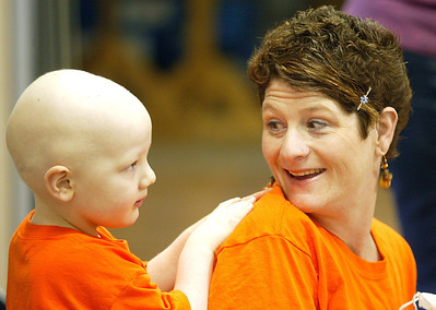 H. Rick Bamman - hbamman@shawmedia.com Sean Keller watches Zion Lutheran School students with his mom Valerie Keller before the shave-a-thon in Marengo.