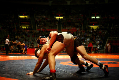 lbooth@shawmedia.com - Lance Booth Richmond's Jack Dechow wrestles against Montini's Jake Turk at the ISHA 2A Individual State Wrestling Tournament during the semi-final round at University of Illinois in Urbana-Champaign on Friday, February 17, 2012. Dechow won the 182 weight class with a 23-8 technical fall in 4:16.