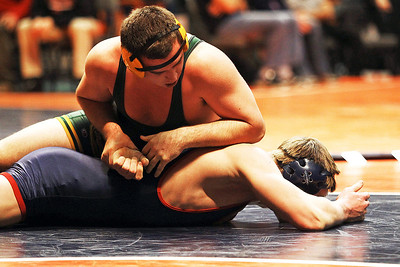 Lance Booth-lbooth@shawmedia.com Crystal Lake South's Mike Romanelli wrestles against Ben Threloff  of St. Rita at the ISHA 3A Individual State Wrestling Tournament during the first round consolations at University of Illinois in Urbana-Champaign on Friday, February 17, 2012. Romanelli won with a 6-4 decision in overtime.