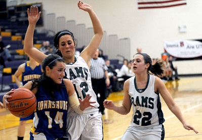 Sarah Nader - snader@shawmedia.com Johnsburg's Tayelor Neiss (left) is guarded by Grayslake Central's Claire Brennan (center) while se tries to get closer to the basket during the fourth quarter of Friday's Wauconda Regional final on February 17, 2012. Grayslake Central won, 48-18.