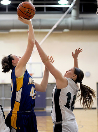 Sarah Nader - snader@shawmedia.com Johnsburg's Ashley Schuld (left) is guarded by Grayslake Central's Maddy Miller during the fourth quarter of Friday's Wauconda Regional final on February 17, 2012. Grayslake Central won, 48-18.