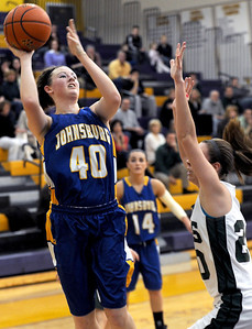 Sarah Nader - snader@shawmedia.com Johnsburg's Ashley Schuld (left) is guarded by Grayslake Central's Beth Arnold while she takes a shot during the third quarter of Friday's Wauconda Regional final on February 17, 2012. Grayslake Central won, 48-18.