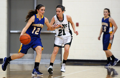 Sarah Nader - snader@shawmedia.com Grayslake Central's Sarah Kuligowski (right) guards Johnsburg's Stephanie Cherwin while she brings the ball towards the basket during the second quarter of Friday's Wauconda Regional final on February 17, 2012. Grayslake Central won, 48-18.