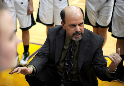 Sarah Nader - snader@shawmedia.com Grayslake Centrals head coach Steve Ikenn talks to the team during Friday's Wauconda Regional final against Johnsburg on February 17, 2012. Grayslake Central won, 48-18.