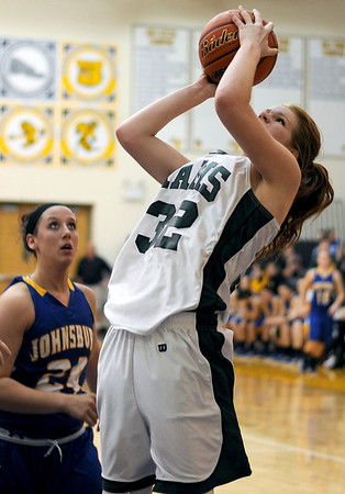 Sarah Nader - snader@shawmedia.com Grayslake Central's Morgan Dahlstrom takes a shot during the second quarter of Friday's Wauconda Regional final against Johnsburg on February 17, 2012. Grayslake Central won, 48-18.