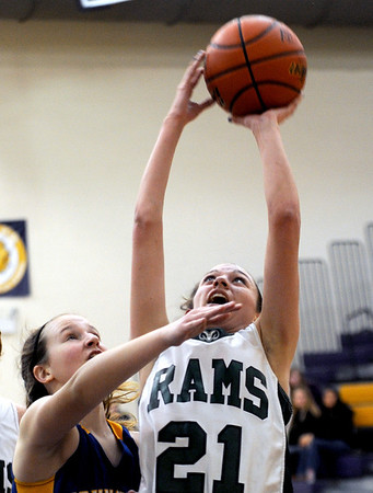 Sarah Nader - snader@shawmedia.com Johnsburg's Kayla Toussaint (left) jumps to block a shot by Grayslake Central's Sarah Kuligowski during the second quarter of Friday's Wauconda Regional final on February 17, 2012. Grayslake Central won, 48-18.