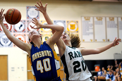 Sarah Nader - snader@shawmedia.com Johnsburg's Ashley Schuld (left) and Grayslake Central's Beth Arnold both jump for the rebound during the third quarter of Friday's Wauconda Regional final on February 17, 2012. Grayslake Central won, 48-18.