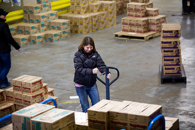 Jenny Kane - jkane@shawmedia.com Sat. Feb. 18, 2012, Daisy Leader of troop 602, Beth Osel tries to operate a handcart while filling orders for girl scout cookies. Girl Scout leaders and volunteers distributed boxes of cookies to individual troops in McHenry county from Affinia's warehouse in McHenry. The volunteers started organizing and loading boxes at 7 am.