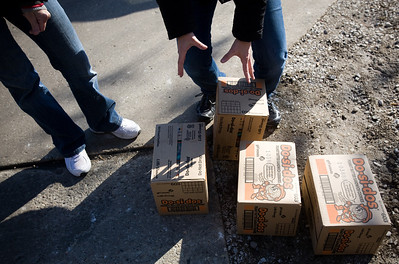 Jenny Kane - jkane@shawmedia.com Sat. Feb. 18, 2012, Daisy scout leaders of troop 602, Beth Osel, (left) and Stacy McCormick, (right) load boxes of girl scout cookies into their vans. The volunteers started organizing and loading boxes at 7 am.