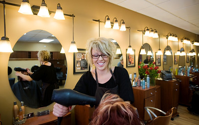 Jenny Kane - jkane@shawmedia.com Sat. Feb. 18, 2012, Brandi Weber styles Tia Zeek's hair at Visions Salon in McHenry. Weber has been cutting hair for 11 years and has been working for the same company since she was 16 years-old. Weber will be styling hair for the 2012 Oscars. She was chosen out of 80 stylists that work for Surface to fly to Los Angeles.