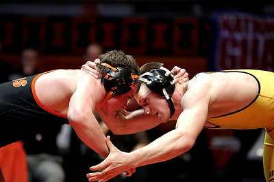 Lance Booth - lbooth@shawmedia.com  Harvard's Don Stott, left, wrestles against Herrin's Drake Holland at the IHSA 1A Individual State Wrestling Tournament during the championship round at University of Illinois in Urbana-Champaign on Saturday, February 18, 2012. Stott won with a fall at 8:15 in overtime in the 170 weight class.