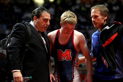 Lance Booth - lbooth@shawmedia.com  Marmion's George Fisher, center, gets support from coaches Joe Silvestro, left and Dean Branstetter after losing the 126 weight class 2A Individual State Wrestling Tournament at University of Illinois in Urbana-Champaign on Saturday, February 18, 2012. Fisher lost the 126 weight class championship against Civic Memorial's David Pearce with a decision of 3-6.