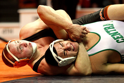 Lance Booth - lbooth@shawmedia.com  Crystal Lake Central's Gage Harrah wrestles against Grayslake Central's Joey Valdivia at the IHSA 2A Individual State Wrestling Tournament during the championship round at University of Illinois in Urbana-Champaign on Saturday, February 18, 2012. Harrah won the championship in the 195 weight class with a 6-2 decision.