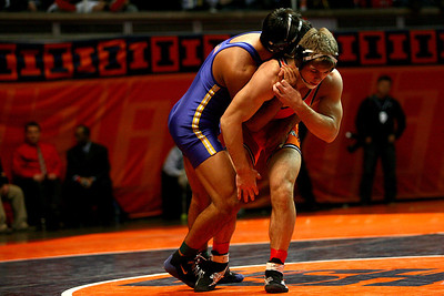 Lance Booth - lbooth@shawmedia.com  Minook'as Jake Residori, right, wrestles against Sandburg's Ricky Robertson at the IHSA 1A Individual State Wrestling Tournament during the championship round at University of Illinois in Urbana-Champaign on Saturday, February 18, 2012. Residori won the 170 weight class championship with a decision of 7-3.