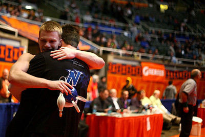 Lance Booth - lbooth@shawmedia.com  St. Charles's North Tim Noverini hugs his coach Gary Conrad at the IHSA 3A Individual State Wrestling Tournament during the fifth place round at University of Illinois in Urbana-Champaign on Saturday, February 18, 2012. Noverini placed 5th in the 152 weight class with a 3:17 fall against Marist's Peter Andreotti.