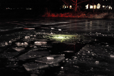 Sarah Nader - snader@shawmedia.com A glow stick illuminates under the ice of a pond in the 3700 block of Windmere Lane in Johnsburg. Fire and rescue officials rescued Patrick Rorig of Johnsburg after he fell through the ice while playing hockey with his son on Sunday, February 19, 2012. Ice divers pulled Rorig out of the pond after searching for 32 minutes. He was then flown to Advocate Condell Medicall Center in Libertyville.